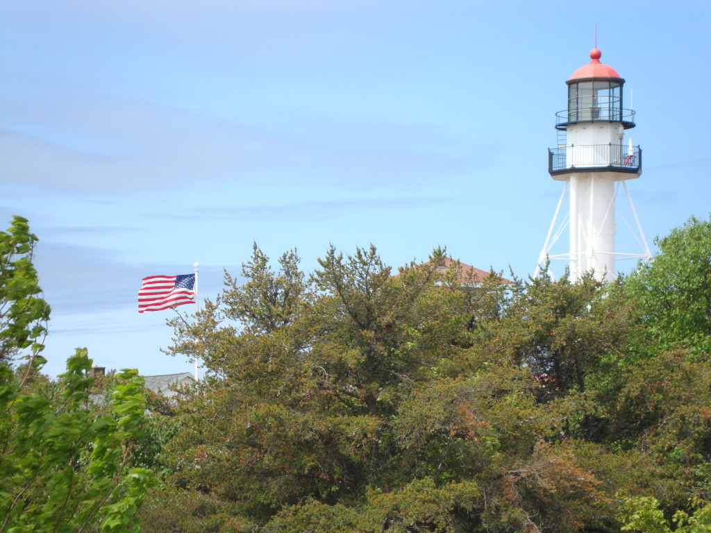 Lighthouse With American Flag